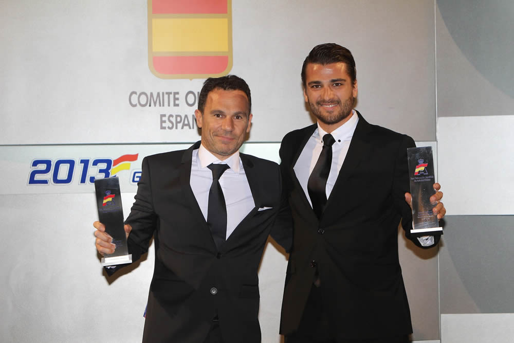 Dimitris Deverikos and Isaak Tutumlu accepting the first position prize for the Spanish Iber GT Championship 2013 in the gala organized by the Royal Spanish Motorsport Federation