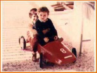 I think you could tell that Dimitris was born behind of the steering wheel of a race car. Photo of him (driving) atthe age of three and his sister Mari (behind him).