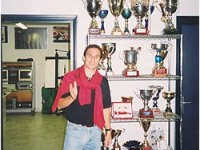 Dimitris Deverikos in front of his trophies collection